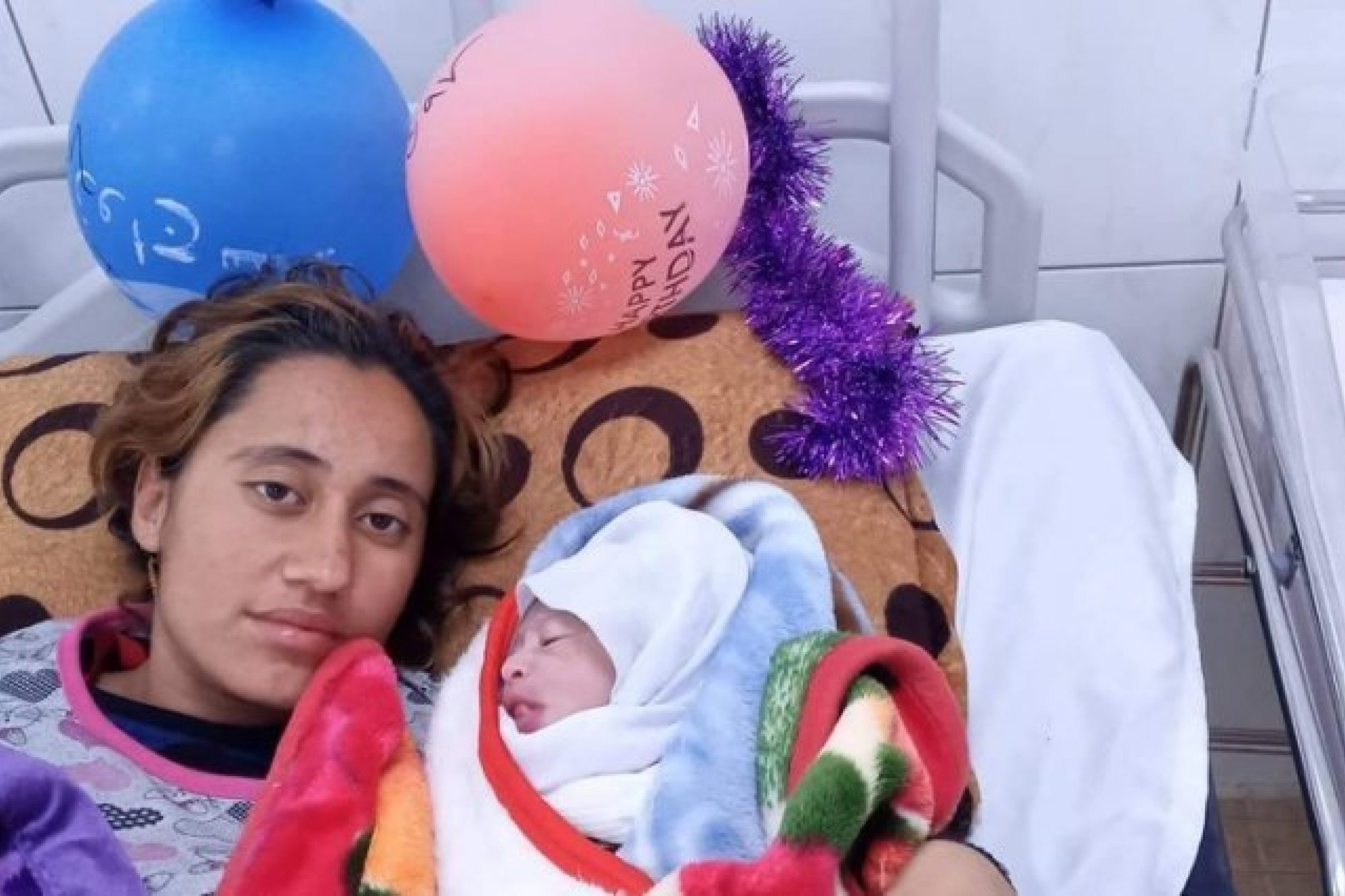Halida with her little boy in Iraq